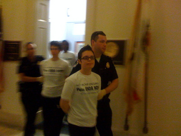 Janine Carmona is escorted from House Speaker Nancy Pelosi's office by Capitol Police a little past 7 p.m. Thursday evening. She was among five people arrested as the result of a protest calling for a vote this month on the Employment Nondiscrimination Act.